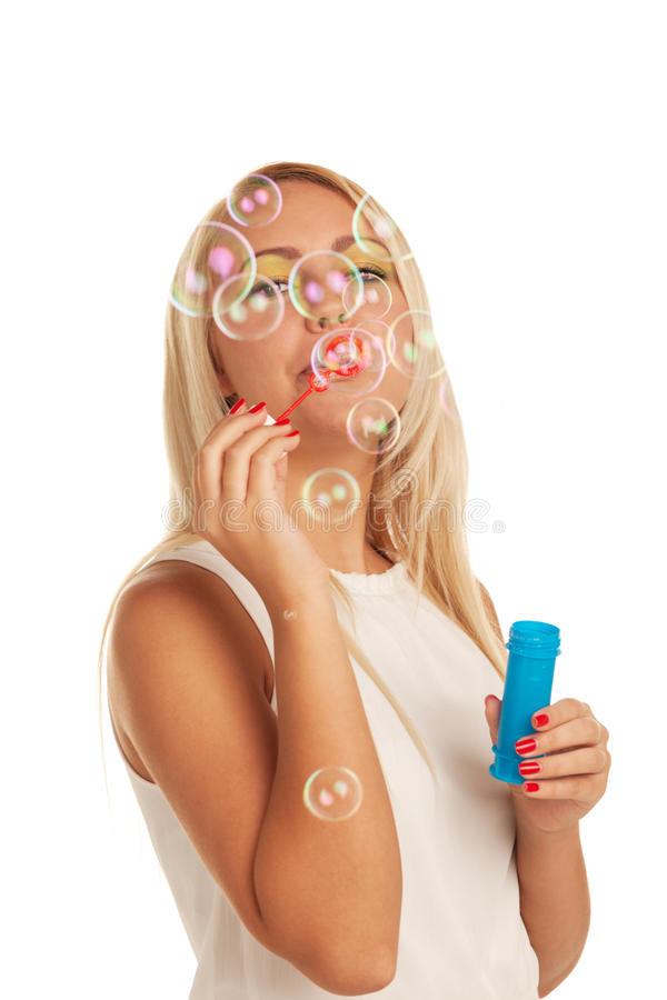 Behind the bubbles. Girl playing with soap bubbles royalty free stock photography