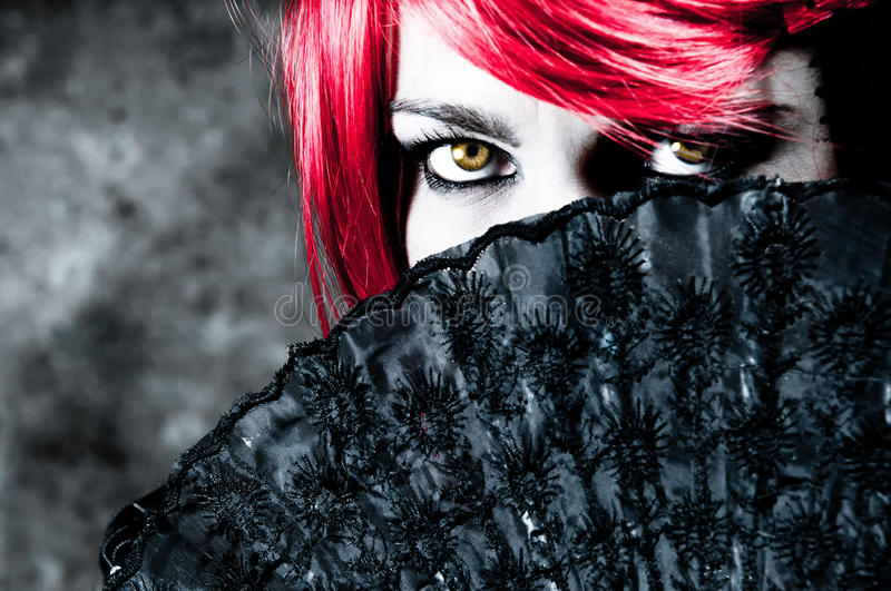 Download Behind a fan stock image. Image of dress, evil, looking - 16538311
