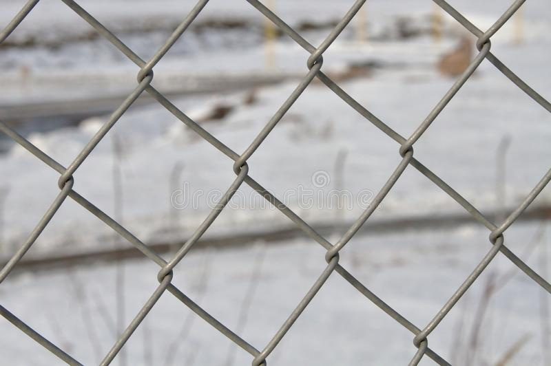 Behind the fence. Area surrounded with steel fence stock photo