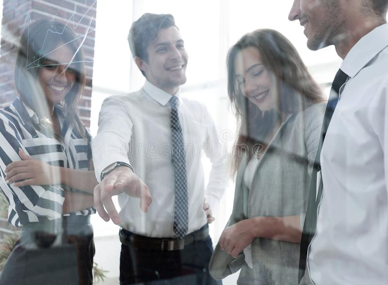 From behind the glass.business team in the officce stock images