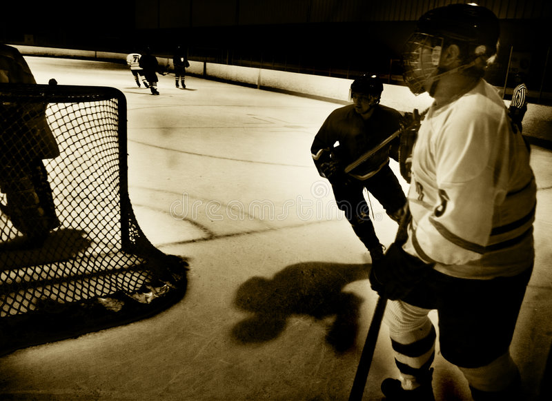 Behind the hockey net stock images