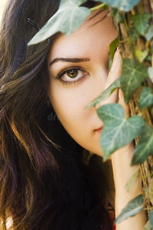 behind leaves woman στοκ εικόνα