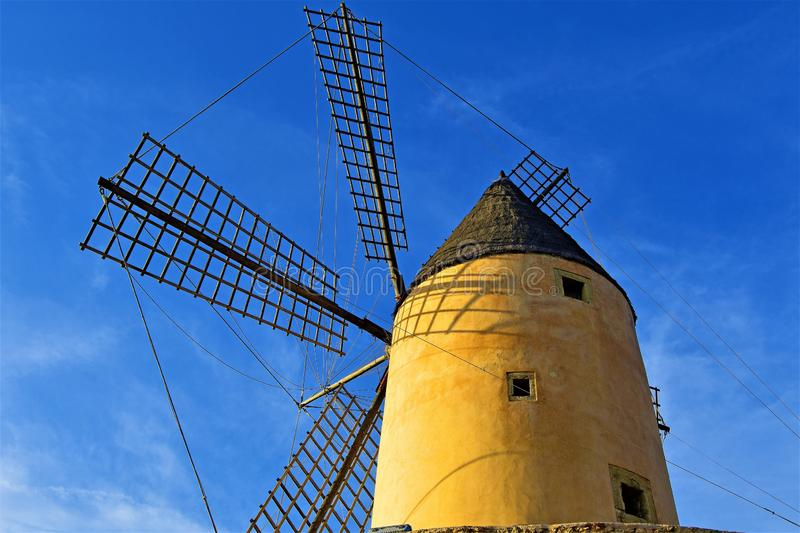 Behind a Majorca Windmill, in Santa Ponca, Majorca, Spain. A clear blue sky amd ambient lighting at dusk, helped to capture this well preserved traditional stock photo