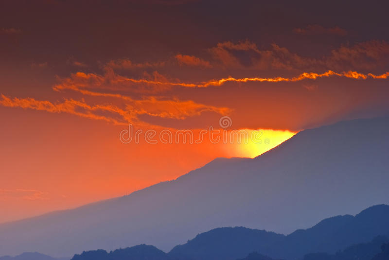 Behind mountains stock images