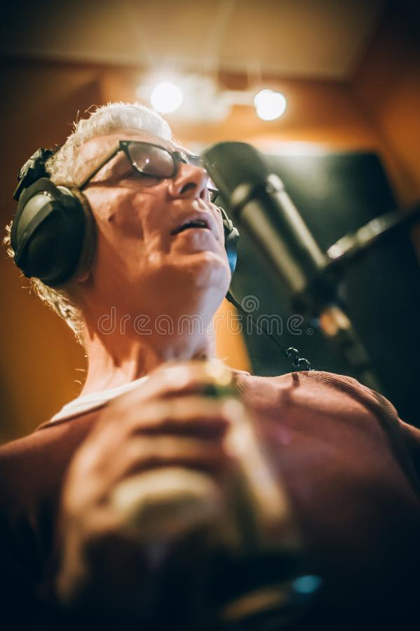 Behind scene. Famous alternative male singer practice singing on microphone stock images