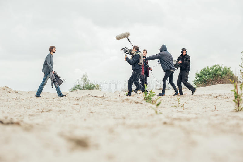Behind the scene. Film crew filming movie scene outdoor. Behind the scene. Film crew team filming movie scene on outdoor location. Group cinema set stock photo