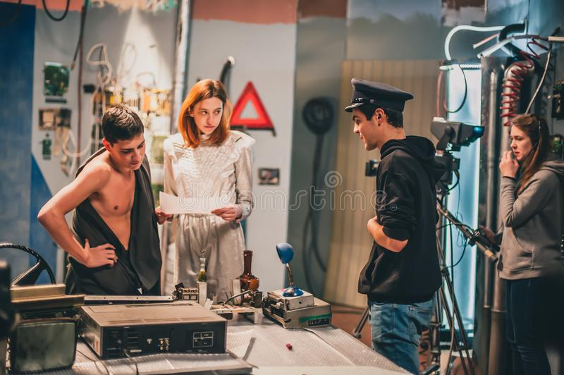 Behind the scene. Film crew filming movie scene in studio. Behind the scene. Film crew team filming movie scene on studio. Group cinema set stock images