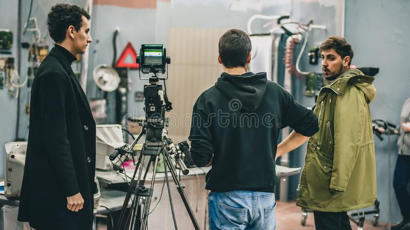 Behind the scene. Film crew filming movie scene in studio. Behind the scene. Film crew team filming movie scene on studio. Group cinema set royalty free stock images
