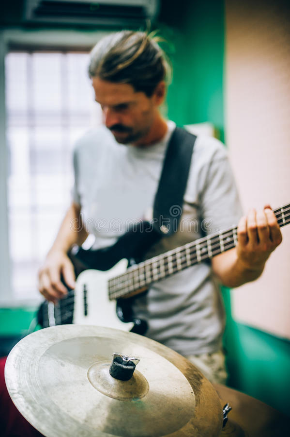 Behind scene. Guitarist practice playing guitar in messy music s stock photography