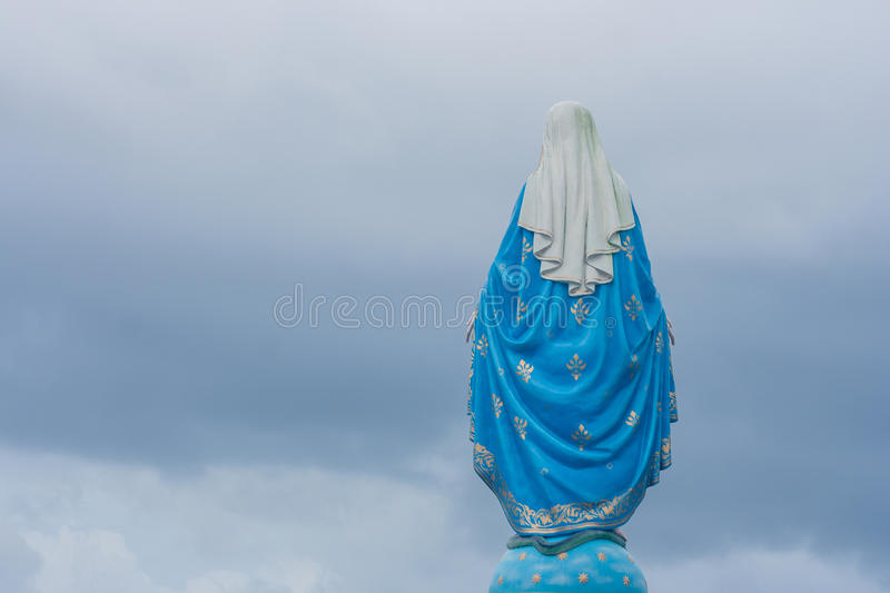 Behind view of The Blessed Virgin Mary statue standing in front of The Roman Catholic Diocese. stock photos