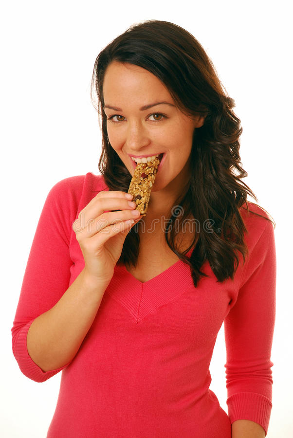 Beißender Getreidestab der Frau lizenzfreie stockfotografie