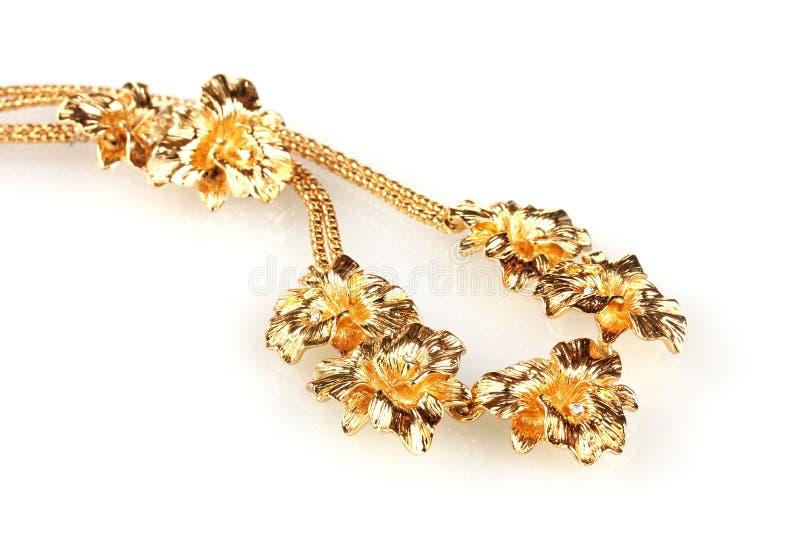 Bei collana ed orecchini dell'oro immagini stock libere da diritti