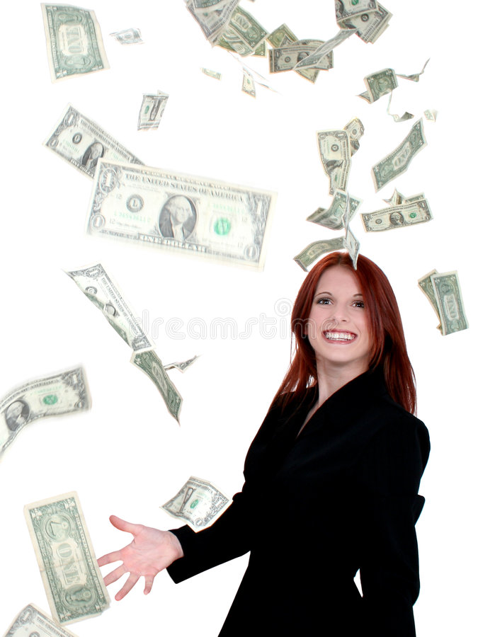 Bei giovani soldi di lancio della donna di affari in aria immagini stock libere da diritti
