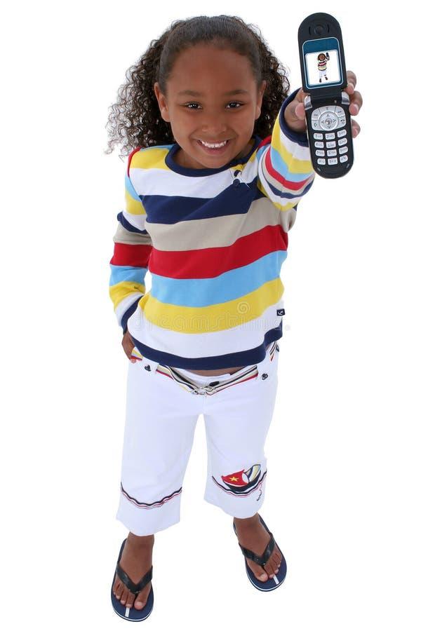 Bei sei anni con il cellulare sopra bianco fotografia stock libera da diritti