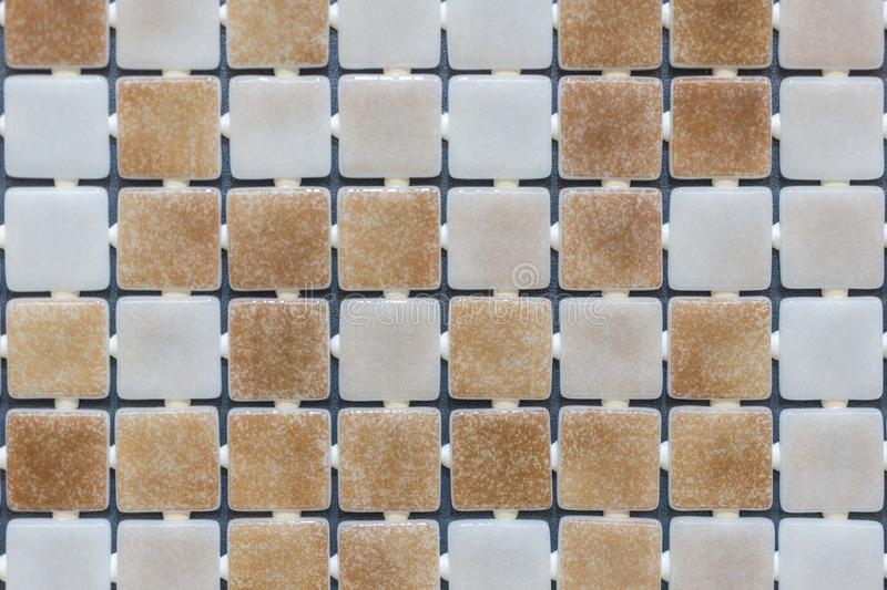 Beige abstract mosaic background. abstract square pixel mosaic wall background and texture. brown glass mosaic tile background stock image