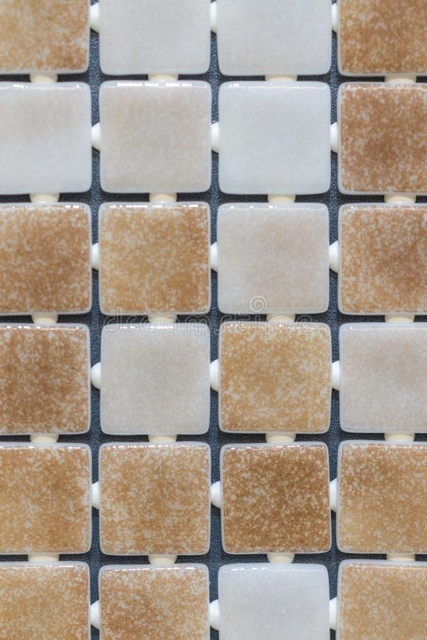 Beige abstract mosaic background. abstract square pixel mosaic wall background and texture. brown glass mosaic tile background royalty free stock photos