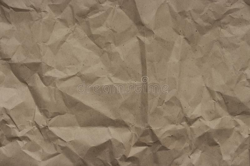 Beige background crumpled craft wrapping paper, texture stock images