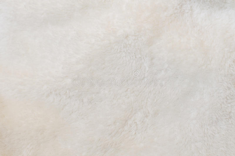 Beige background of plush fabric. Blurred background of soft tissue. Beige background of plush fabric stock photo