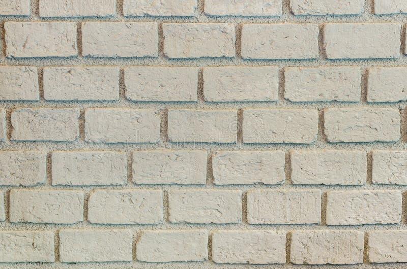 Beige Backsteinmauermuster stockbilder