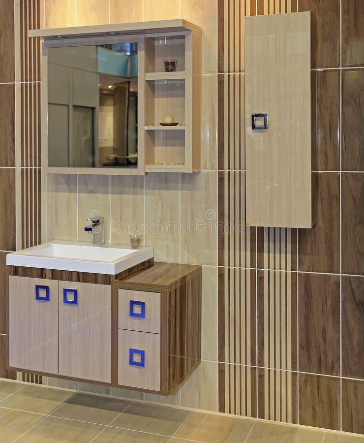 Beige Bathroom. Modern Cabinets in Beige Bathroom Interior royalty free stock photos