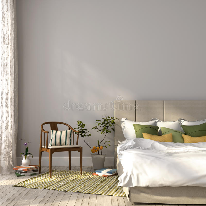 Beige bed with green decor royalty free stock photo