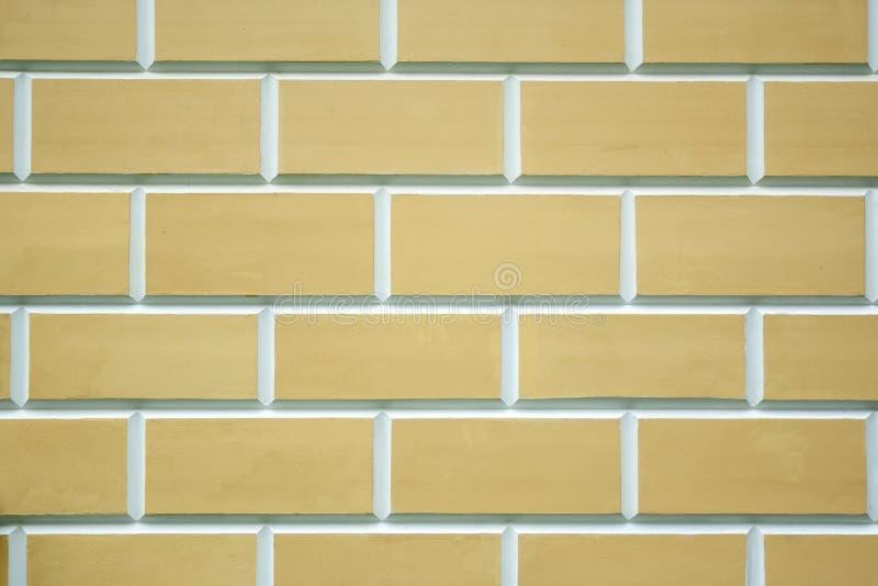 Beige bricks wall texture. New clean beige bricks background royalty free stock images