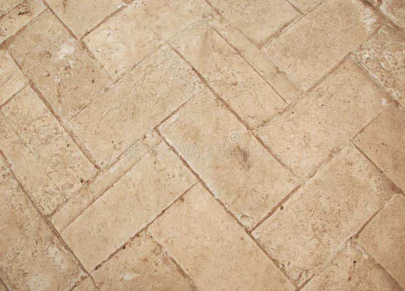 Beige ceramic tile. The beige street old ceramic tile royalty free stock photo