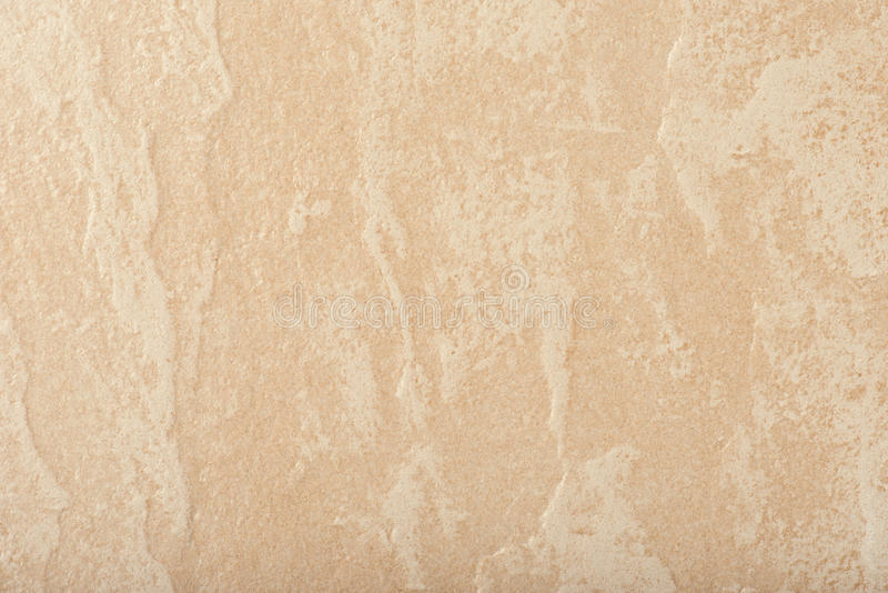 Beige ceramic tile background. The surface of the beige ceramic tiles royalty free stock images