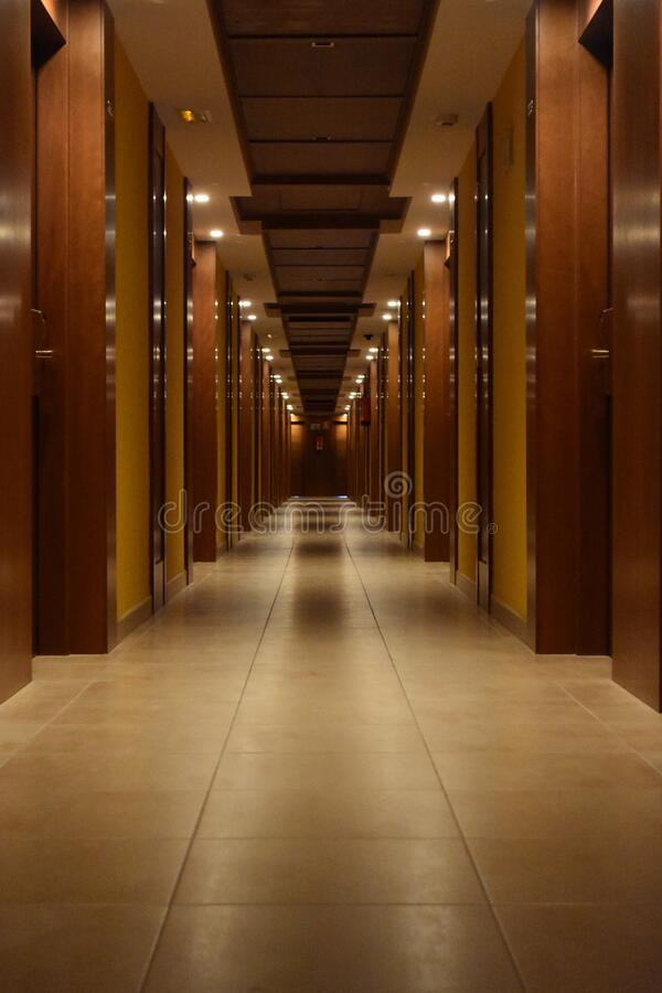 Beige Ceramic Tiled Corridor Inside Building stock image