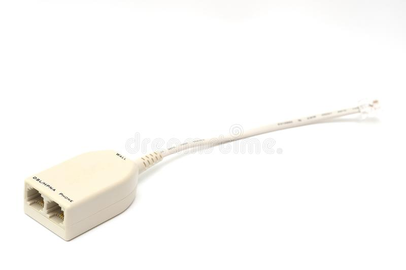 A beige colored micro-filter short cable adapter royalty free stock image