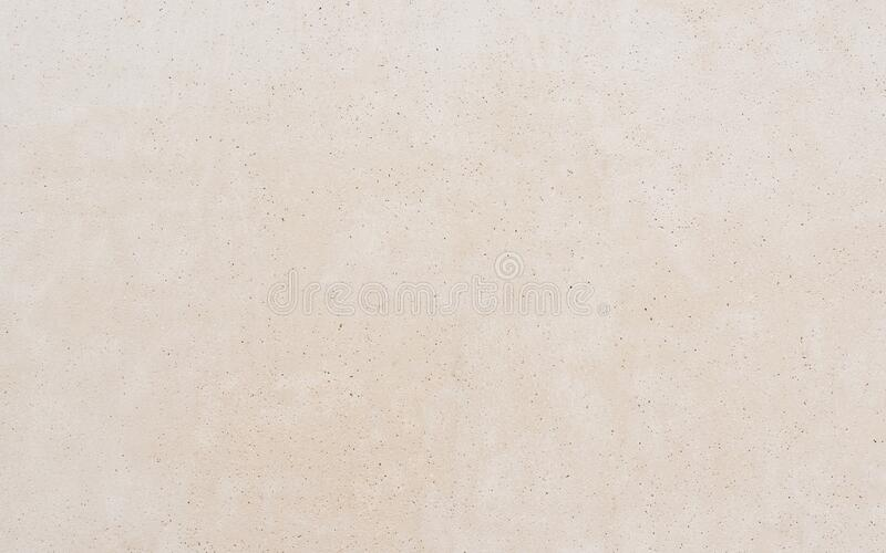 Beige concrete wall texture royalty free stock photography
