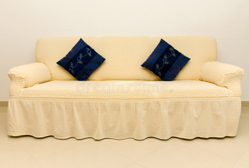 Download Beige Couch And Blue Cushions. Stock Image - Image of lounge, pillow: 5456007