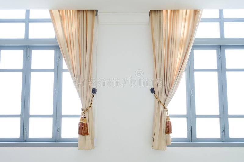 Beige curtains in a classic style. royalty free stock photography