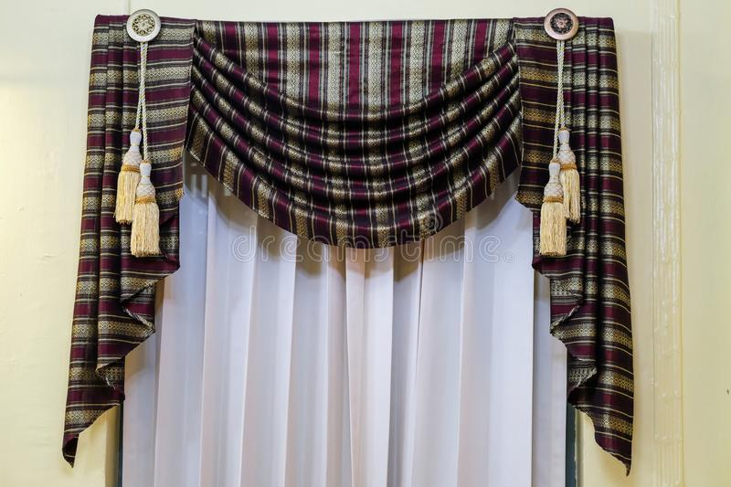 Beige curtains in a classic style. royalty free stock images