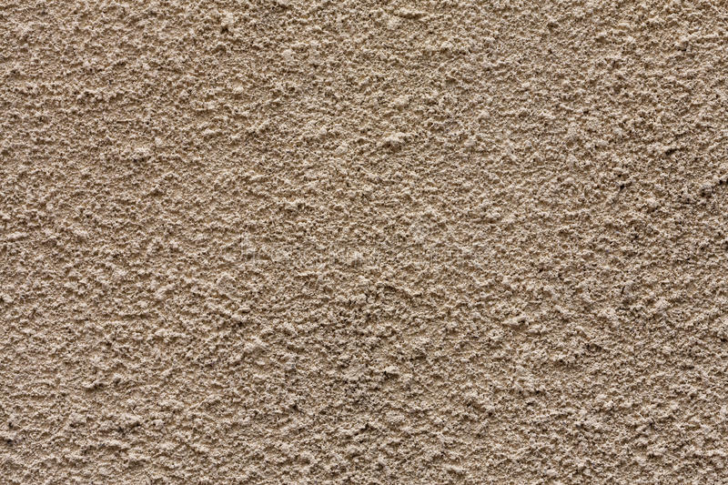 Beige decorative plaster close up. Textural background royalty free stock photos