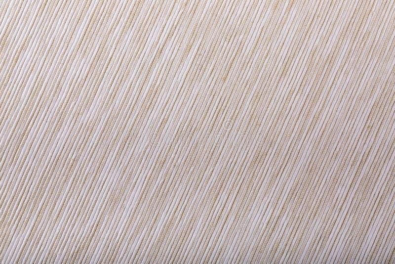 Beige diagonale gestreifte Gewebebeschaffenheit intresting Muster der Beschaffenheit lizenzfreie stockfotos