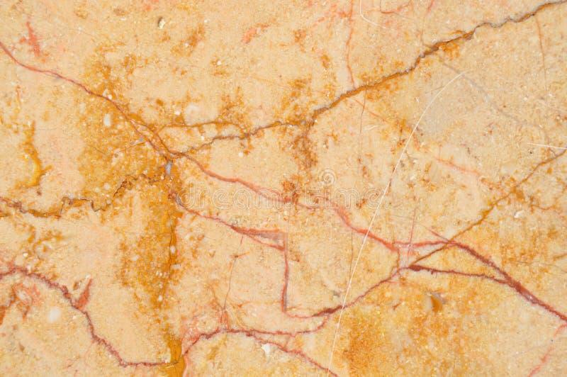 Beige e struttura del marmo dell'oro fotografia stock