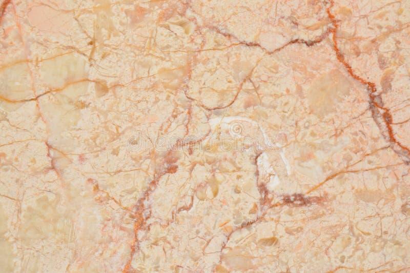 Beige e struttura del marmo dell'oro immagini stock