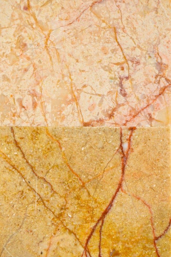 Beige e struttura del marmo dell'oro immagini stock libere da diritti