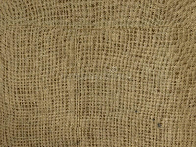 Beige fabric hessian burlap texture background. Beige fabric hessian burlap texture useful as a background stock photo