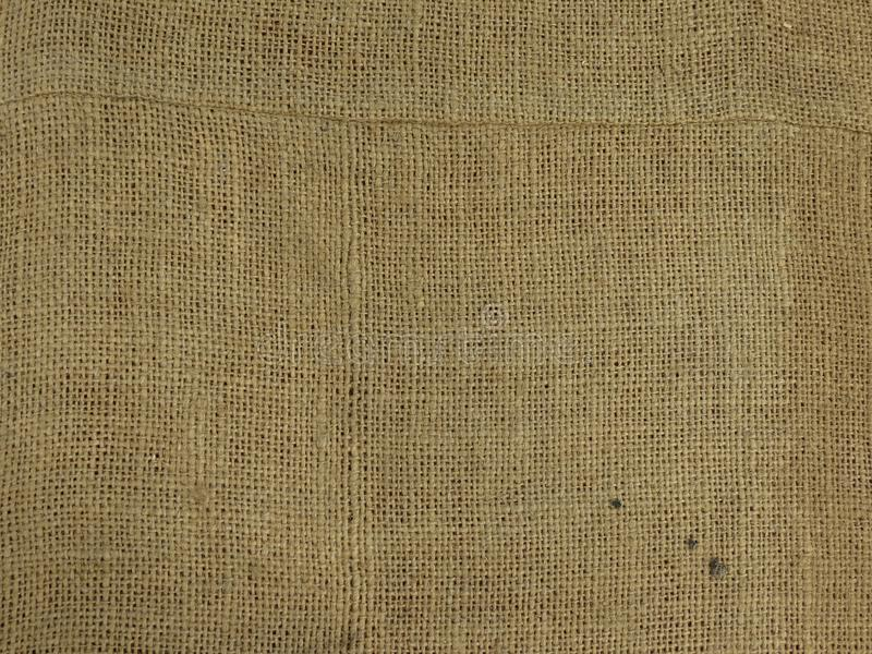 Beige fabric hessian burlap texture background. Beige fabric hessian burlap texture useful as a background stock images