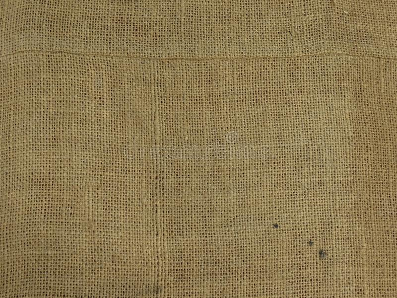 Beige fabric hessian burlap texture background. Beige fabric hessian burlap texture useful as a background stock photos