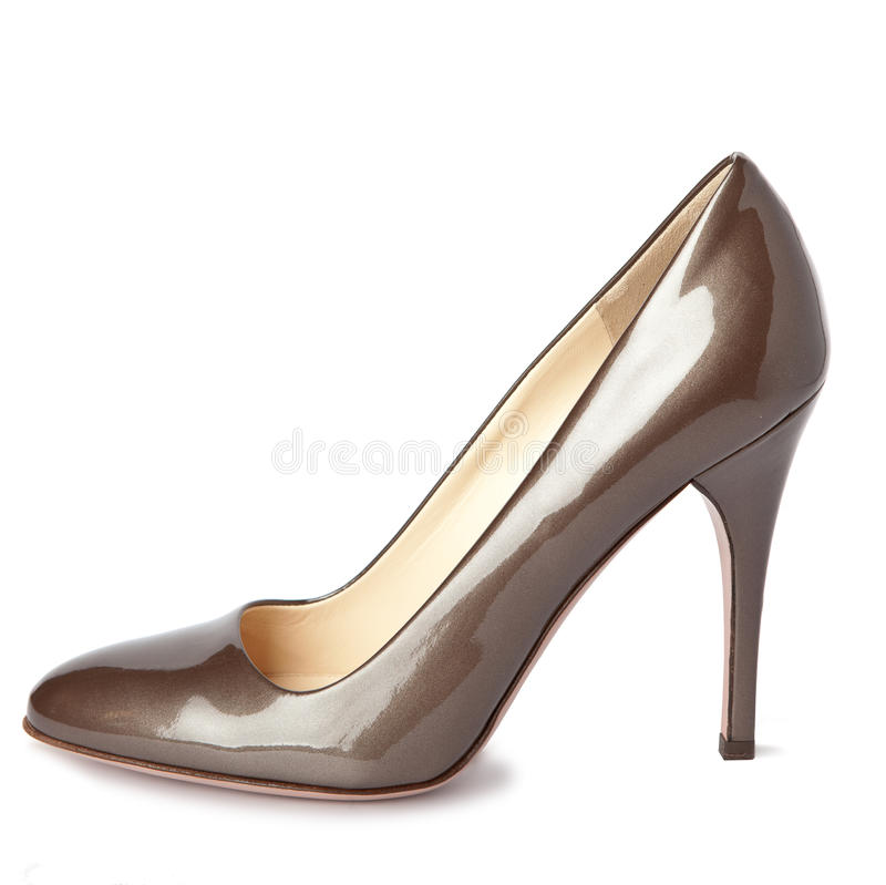 Beige female new shoes on high heel-stiletto. Close up on a white background royalty free stock photography