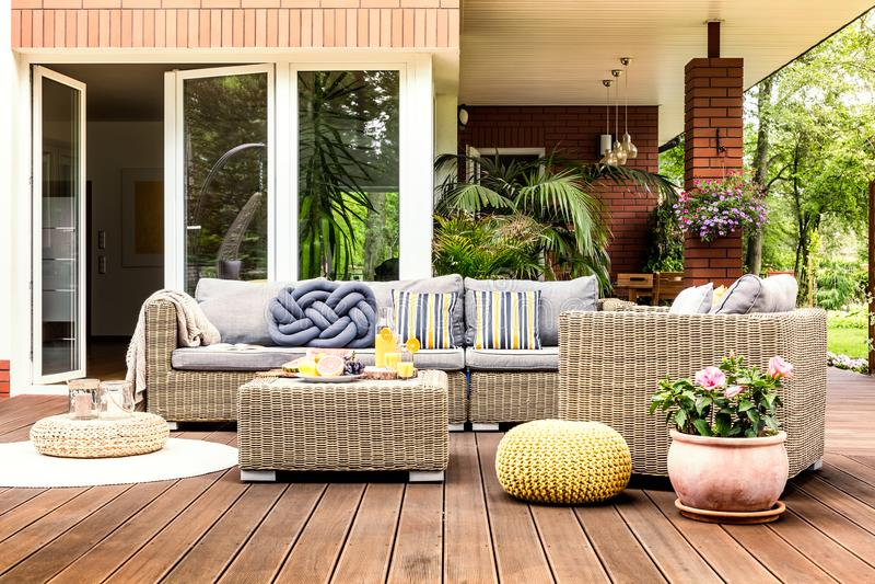 Beige garden furniture on terrace stock photo