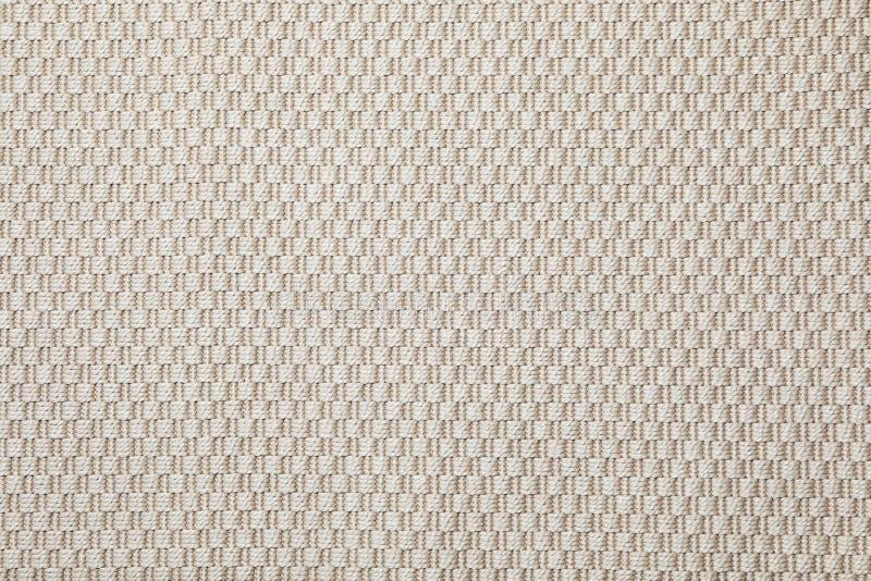 Beige geweven tapijttextuur als achtergrond stock fotografie