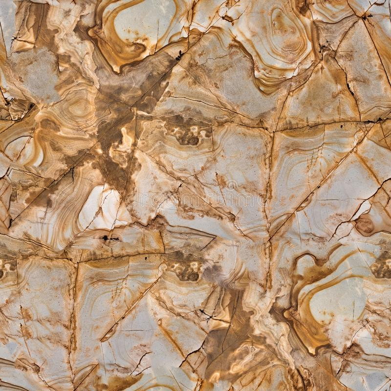 Beige granite stone as background. Seamless square texture, tile ready. High resolution photo royalty free stock photo