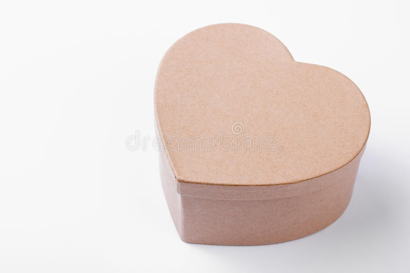 Beige heart shaped present box. stock photography