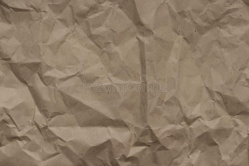 Beige Hintergrund zerknitterte Handwerkspackpapier, Beschaffenheit stockbilder