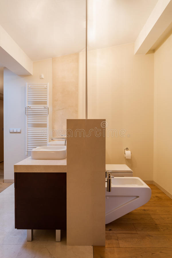 Beige interior of bathroom. In residence stock photography