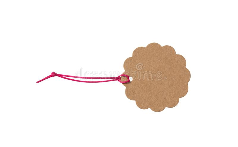 Beige isolated recycle scallop tag with red elastic band top view on a white background royalty free stock photo